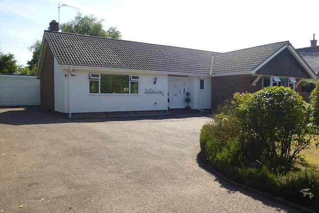 Howards are pleased to offer this Spacious Detached Bungalow, Private plot of over 1/2 an acre! 3 bed, ensuite bath & shower rm. + 'jack & jill' style ensuite, cloakrm, kitchen, open lounge & dining area. PVCu d/g, oil fired c/h, electric dble gate access, south facing rear garden. Double garage.