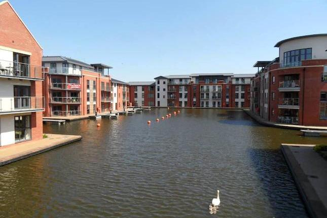 This modern two bedroom waterside apartment is situated on the delightful development known as 'Waters Edge' and is conveniently located for the town centre and its amenities. Overlooking the basin the accommodation on offer and briefly comprises of an open plan living and kitchen area, two bedrooms, master with ensuite and a further bathroom. The apartment benefits further from a balcony to enjoy the development from, double glazing, electric heating and allocated parking. Viewing is essential to appreciate the apartment and its position, available with no upward chain! EPC band C.