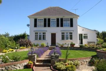A detached four bedroom spacious cottage style family home, situated in an idyllic country location in the heart of The Gower Peninsula