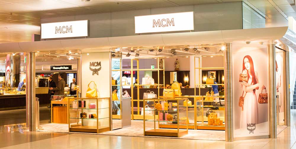 mcm opens airport pop up in its hometown travel retail business. Black Bedroom Furniture Sets. Home Design Ideas